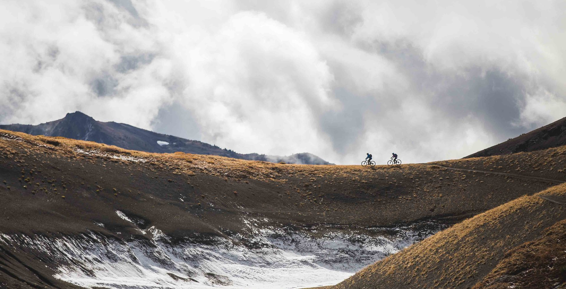 Be it on skis or in the saddle, Mark Abma isn't afraid to put in early mornings, long days, and hefty mileage, such as this big ride in the Chilcotins. Photo: Tom Richards