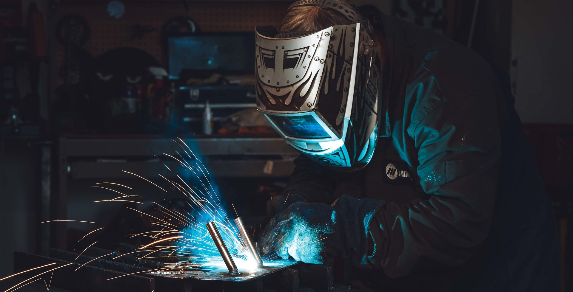 Far from the X-ray machine, Mark Belles indulges in some signature craftmanship while welding a new creation in his garage-turned-workshop.