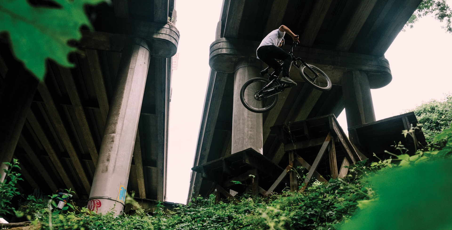 As the first urban mountain bike park in the United States, Colonnade opened the door on an entirely new realm for the sport—and thanks to the then-fledgling Evergreen Mountain Bike Alliance, set the bar for what community-based advocacy could accomplish. Carson Storch styles a 360 while demonstrating proper under-Interstate form.